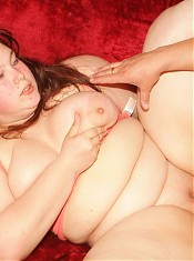 Cute fatty Esther shows off her knockers and makes use of it to work a meaty cock live