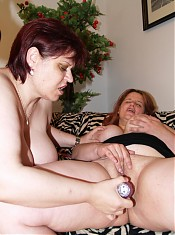 Chubby lesbian chicks Chaste and Marta suck each others nipples and later plug a sextoy up their pussies